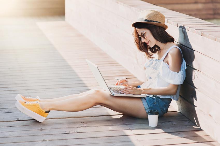 Blogger Girl using Laptop outdoors for Storytelling